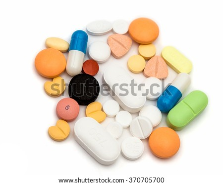 Tablets, different medicines lie on white background, isolated.
