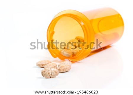 Tablets herbal and bottle of orange on a white background, shoot open corners on the left.