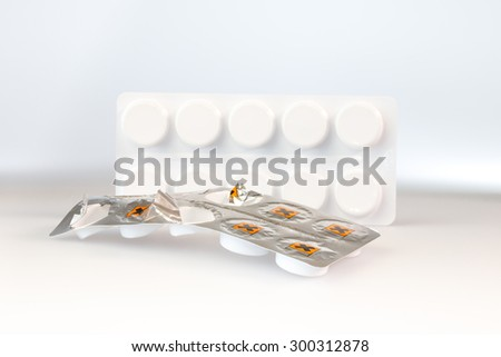 Tablets in a aluminium blister trip with hazard symbol for irritant substance - stock photo