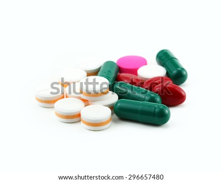 Tablets pills heap color mix therapy doctor flu antibiotic medicine medical on white background - stock photo