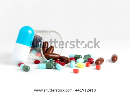 Tablets pills heap color mix therapy drugs doctor flu antibiotic medicine medical - stock photo