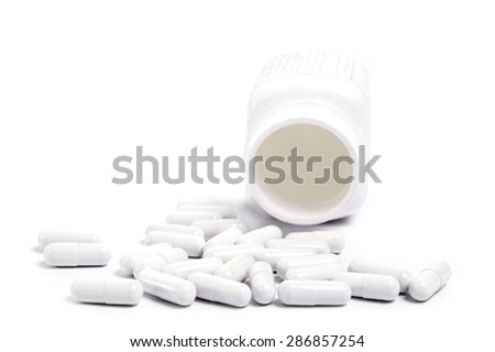 Tablets pills medicine medical on white background - stock photo