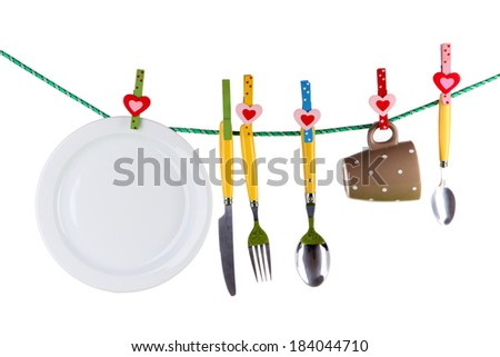 Tableware dried on rope isolated on white - stock photo