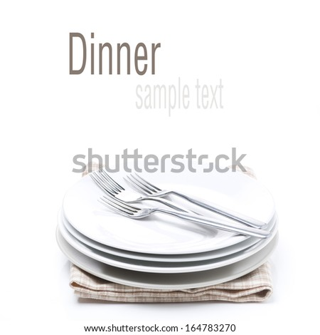 tableware for dinner - plates and forks, isolated on white
