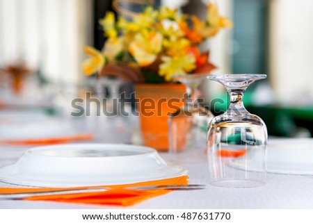 tableware in the restaurant - glasses upside-down, one glass in focus