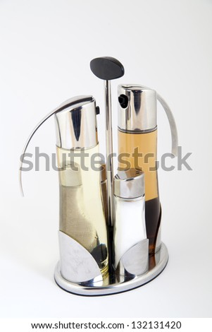 Tableware set of salt, pepper and bottles for oil and vinegar - stock photo