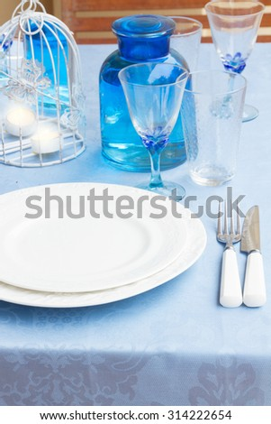 Tableware - set of white plates, cups and utencils close up - stock photo