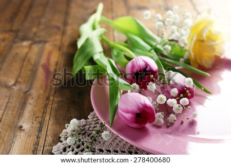 Tableware with flowers on table close up - stock photo