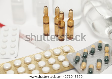 Tabloids and ampulla - stock photo