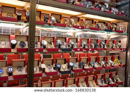 TACHILEIK - AUGUST 3, 2013 : Counterfeit goods of branded watches in black market in Tachileik, Burma. - stock photo