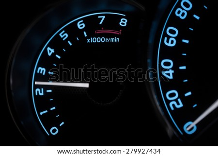 Tachometer close-up background with illuminate light