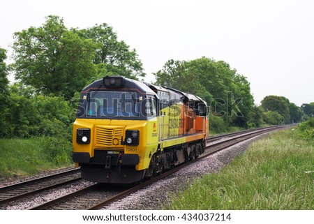TACKLEY, UK - JUNE 7: A Colas Rail operated class 70 diesel loco moves light engine to Bescot traction depot on June 7, 2016 in Tackley. Colas operate 10 class 70 locos out of a total fleet of 48.