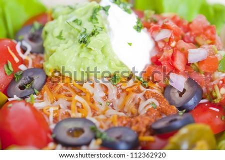 Taco salad in a baked tortilla macro - stock photo