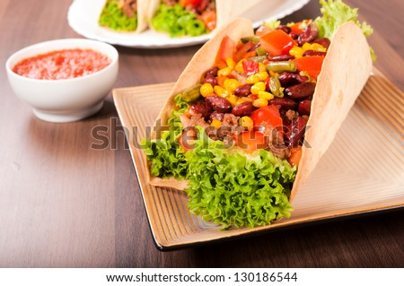 Taco sandwich on the plate - stock photo