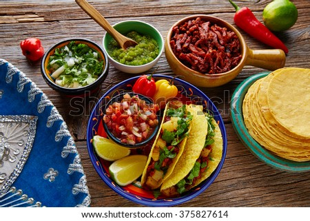 Tacos al pastor Mexican with coriander pineapple and chili - stock photo