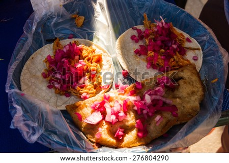 Tacos and etadas on the street in Chiapas, Mexico - stock photo