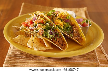 Tacos on a platter with tortillas - mexican food - stock photo