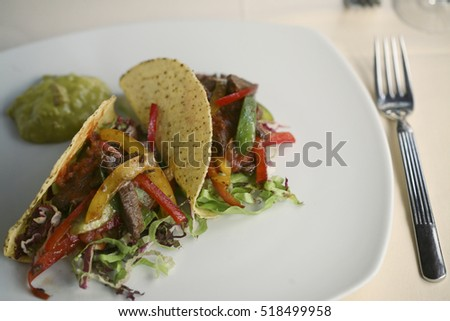 Tacos with beef and grilled vegetables