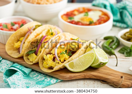 Tacos with  eggs for breakfast and variety of mexican dishes - stock photo