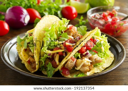 Tacos with pork and tomato salsa. - stock photo
