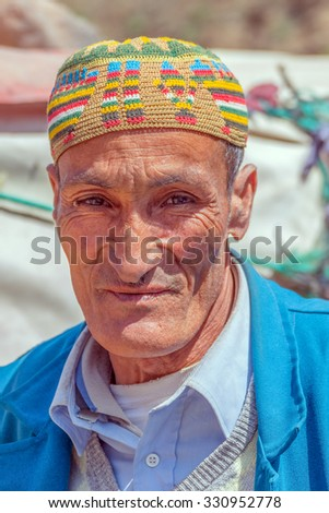 TADDERT, MOROCCO, APRIL 15, 2015: Portrait of local man in traditional headgear  - stock photo