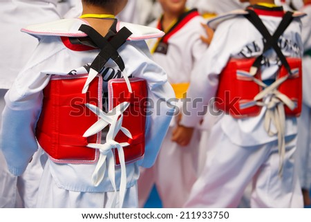 Taekwondo athletes with with uniform and red armour - stock photo