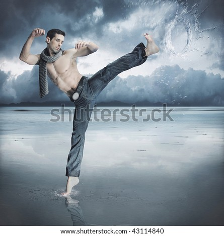 Taekwondo fighter training in the nature - stock photo