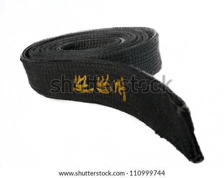 Taekwondo martial arts black belt isolated on white background - stock photo