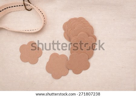 Tag in form of flower on linen background  - stock photo
