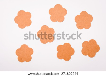 Tag in form of flower on white background   - stock photo