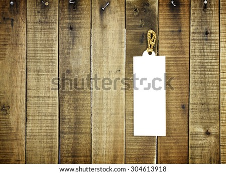 tag label on wooden background for texture - stock photo