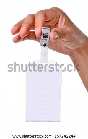 tag name clip in hand on the white background - stock photo