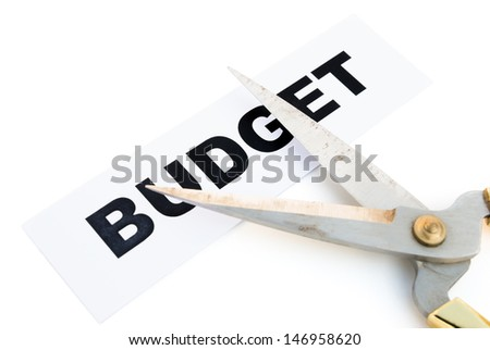 tag of budget and scissors with clipping path - stock photo