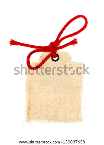 Tag or label with red bow isolated on white - stock photo