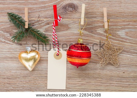 tag with christmas decorations and empty tag  hanging on rope - stock photo