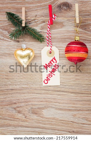 tag with christmas decorations and merry christmas tag  hanging on rope - stock photo