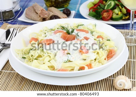 Tagliatelle pasta with cream, salmon and anise - stock photo