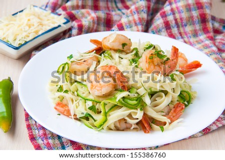 Tagliatelle pasta with fried shrimps and zucchini ribbons, dish of restaurant