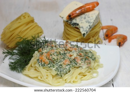 Tagliatelle pasta with shrimps - stock photo