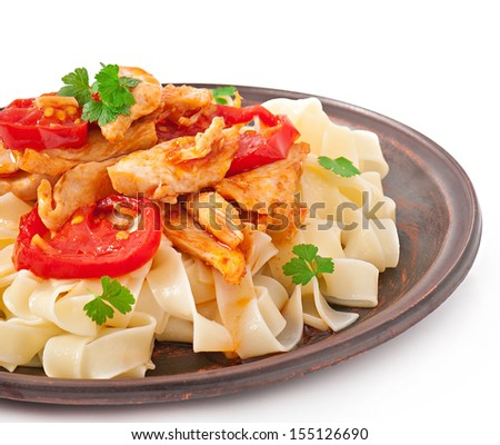 tagliatelle pasta with tomatoes and chicken - stock photo