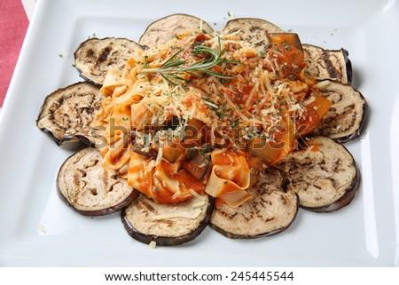Tagliatelle with eggplant - stock photo