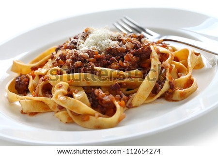 tagliatelle with ragu bolognese sauce, italian pasta cuisine - stock photo