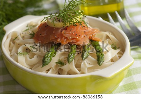 Tagliatelle with smoked salmon and asparagus - stock photo