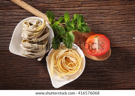 Tagliatelle with tomato and mint - stock photo