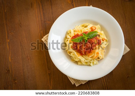 Tagliatelle with tomato sauce - stock photo