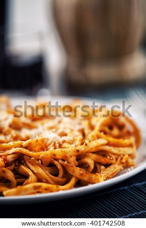 Tagliatelle with tomato sauce and pesto - stock photo