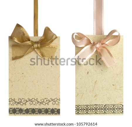 tags with bows isolated on the white - stock photo