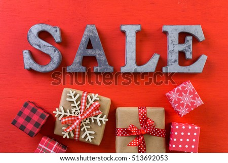 Tags with sale sign on wood board.