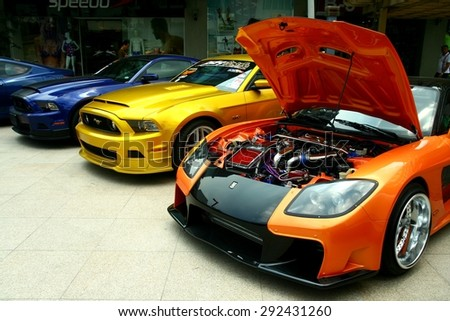 TAGUIG CITY, PHILIPPINES - JUNE 27, 2015: Expensive and customized luxury and race cars are displayed in a car show in Bonifacio Global City. - stock photo