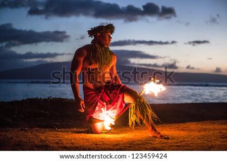 Tahitian dance at night by a Samoan Dancer in Maui - stock photo